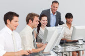 Multi-ethnic business and manager working with computers — Foto Stock