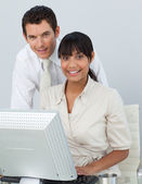 Afro-American businesswoman and caucasian businessman in the off — Stock Photo