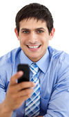 Attractive businessman sending a message — Stock Photo