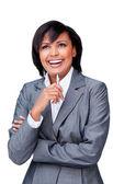 Laughing hispanic businesswoman holding a pen — Stock Photo