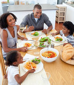 Happy family dining together — Stock Photo