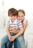 Cute girl hugging her little brother — Stock Photo
