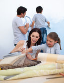 Young family renovating home after moving — Stock Photo