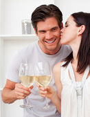 Close-up of A Woman kissing her boyfriend and toasting with whit — Stock Photo