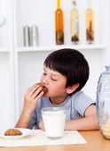 Boy eating cookies — Stock Photo