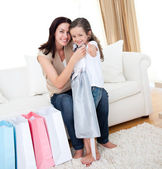 Little girl trying on a dress with her mother — Stock Photo