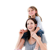Cheerful mother giving piggyback ride to her daughter — Stock Photo