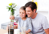 Happy father and his daughter having breakfast together — Stock Photo