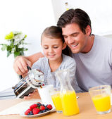 Cheerful father and his daughter having breakfast together — Photo