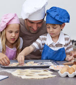 Portrait of father and children baking — Stock Photo
