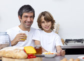 Happy father and son having breakfast together — Stock Photo