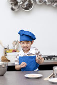 Little child ready to bake — Stock Photo
