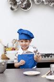 Little child ready to bake — Stock Photo