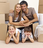 Family in new house playing with boxes — Stock Photo