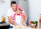 Portrait of a smiling father and his son preparing a meal — Stock Photo