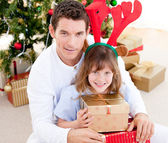 Handsome father celebrating christmas with his daughter — Stock Photo