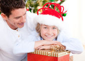 Handsome father celebrating christmas with his son — Stock Photo