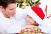 Attractive father celebrating christmas with his son — Stock Photo