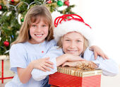 Adorable childrens celebrating christmas — Stock Photo