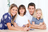 Positive family playing together — Stock Photo
