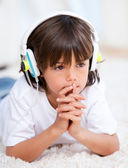 Pensive boy listenning music — Stock Photo