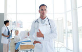 Confident doctor in a hospital ward — Stock Photo