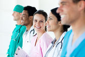 International medical team standing in a line — Stock Photo