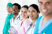 Smiling medical team in a line — Stock Photo