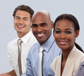 Smiling multi-ethnic business in a line — Stock Photo