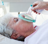 Close-up of a female patient receiving oxygen mask — Stock Photo