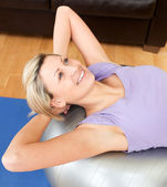 Smiling woman doing exercice — Stock Photo