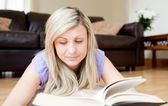 Beautiful woman reading a book — Stock Photo