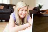 Beautiful woman using a laptop — Stock Photo