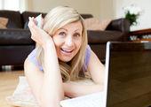 Joyful woman using a laptop — Stock Photo