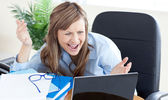 Astonished businesswoman looking at the laptop — Stock Photo