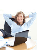 Smiling businesswoman looking at the laptop — Stock Photo