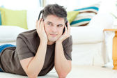 Pensive man listening the music — Stock Photo