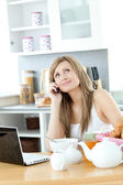 Pensive woman having a breakfast in the kitchen — Stock Photo