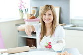 Attractive woman cooking cakes in the kitchen — Stock Photo