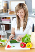Delighted woman preparing a healthy meal in the kitchen — Stock Photo