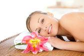 Portrait of a beautiful woman having a massage — Stock Photo