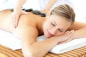 Sleeping woman having a massage — Stock Photo
