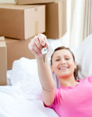 Lively woman relaxing on a sofa with boxes — Stock Photo