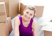 Beautiful woman unpacking box — Stock Photo
