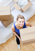 Radiant woman holding a box — Stock Photo