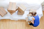 Caucasian woman holding a box — Stock Photo