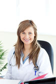 Smiling female doctor looking at the camera — Stock Photo