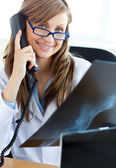 Happy female doctor talking on the phone — Stock Photo