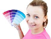 Caucasian woman choising colours — Stock Photo