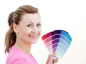 Bright woman choising colours — Stock Photo